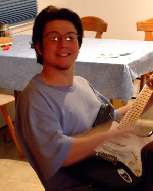 Guitar in hand (computer is to the right) February 14, 2007