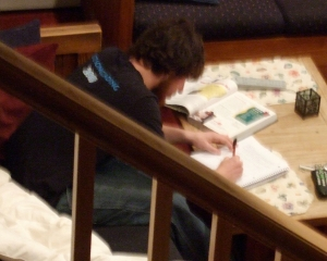 I love this photo. It's a little fuzzy because I had to snap it quickly. It's an extremely rare picture of Jonah ... doing homework! Something about wanting to graduate from high school. June 2008