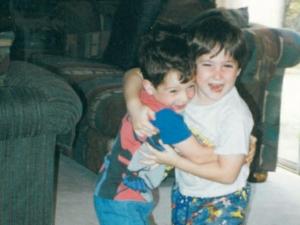 """Batman Animated"" wrapped around Jonah. Jonah wrapped around buddy Ryan. Cleveland, circa 1995."