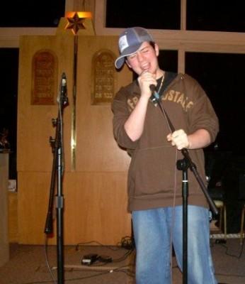 Jonah emcee'ing Academy Coffeehouse December 2006