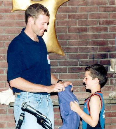 Darren presents an RA Associates t-shirt to proud cadet Jonah Dreskin (Kutz 1998)
