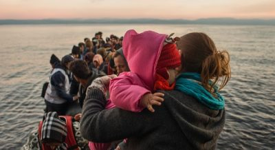 A dinghy arrives in Lesvos, Greece, on 30th November, with more than 60 Syrian refugees, most of them children.